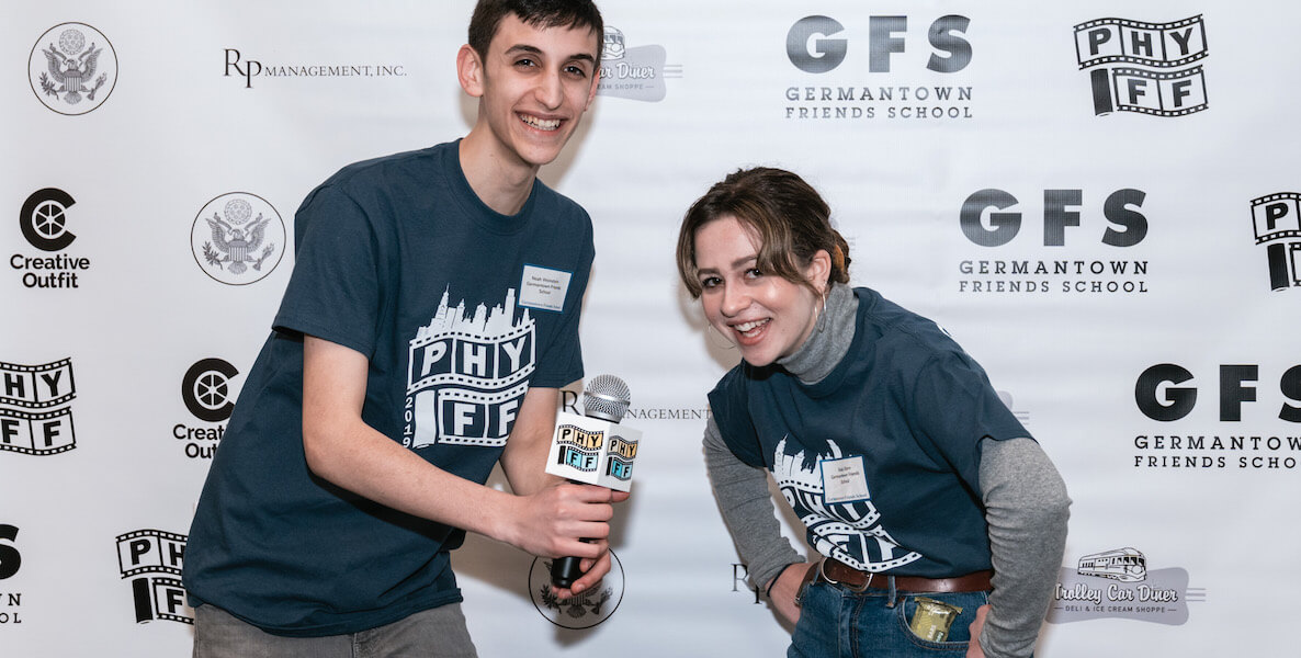 Former Philadelphia Youth Film Festival organizers Noah Weinstein and Raia Stern hold down interviews on the red carpet.